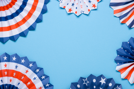 4th of July banner. Paper fans stars USA Independence Day flag colors template. Stock Photo