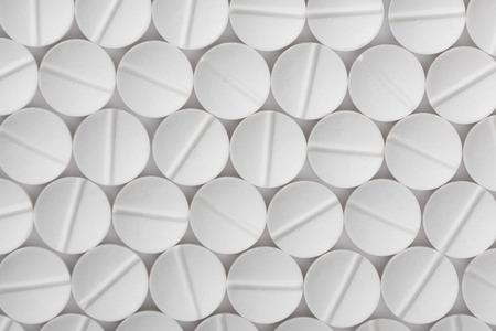 Sfondo di pillole bianche. Macro del modello delle compresse.