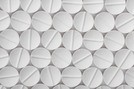 Weiße Pillen Hintergrund. Tablets Mustermakro.