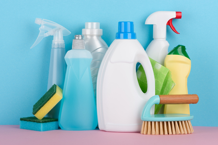 Cleaning liquids and tools set for different housework. Bathroom, kitchen, office house building cleaning service equipment. Stock Photo