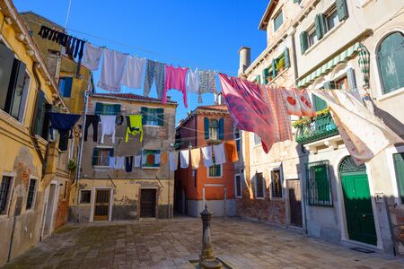 Venice Italy street with laundry washed clothes hanging out to dry on ropes