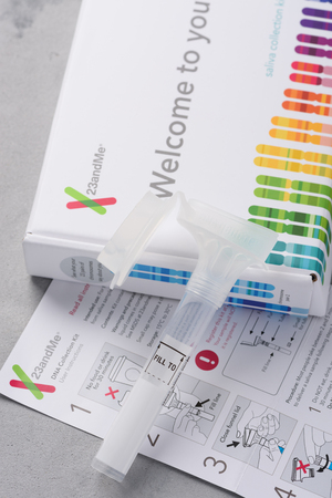 Kiev, Ukraine - 17 October 2018: 23andMe new personal ancestry genetic test saliva collection kit, tube, box and instructions. Illustrative editorial.