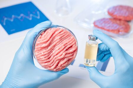 Meat in Petri dish and liquid chemical in bottle. Livestock ilness antibiotic treatment or cultured lab meat concept. Stok Fotoğraf