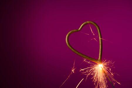 Burning sparkler in shape of heart Stock fotó