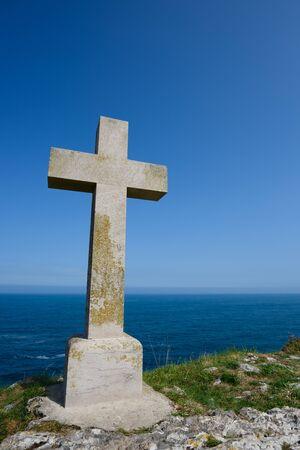 Christian cross on ocean shore