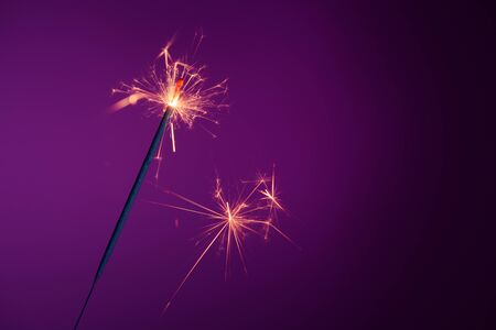 Brightly burning party sparkler with sparks