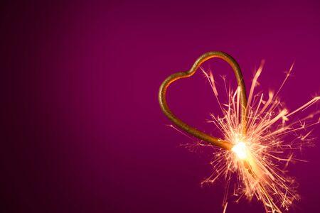 Burning sparkler in shape of heart. Wedding love Valentines day banner. Stock fotó
