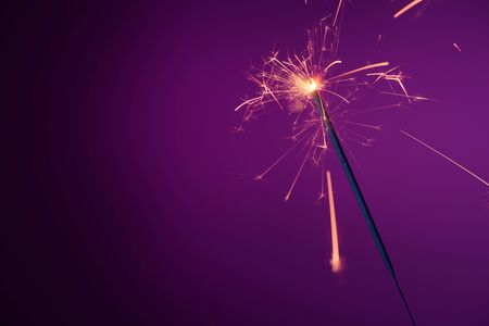 Brightly burning sparkler with copy-space.