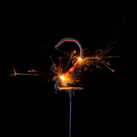 Burning sparkler in shape of number two, digit 2, isolated on black background. Stock fotó