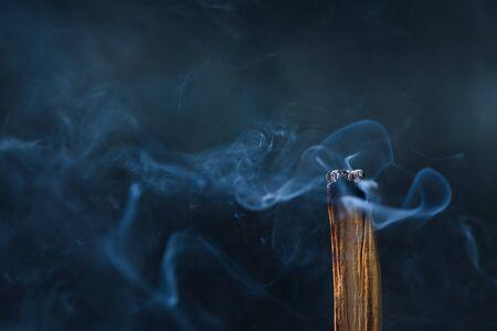 Palo Santo, holy sacred tree stick, burning with aroma smoke.
