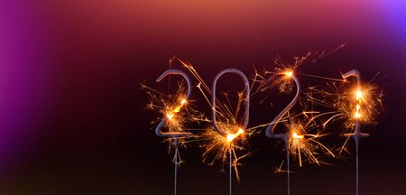 Happy New Year 2021 banner template. Digits of year 2021 made by burning sparklers isolated on black background.