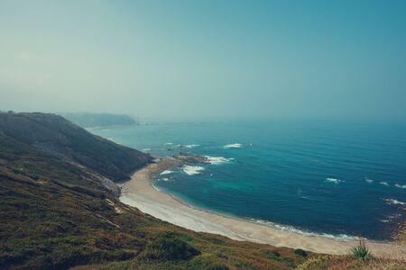 Empty sandy ocean beach vintage toned