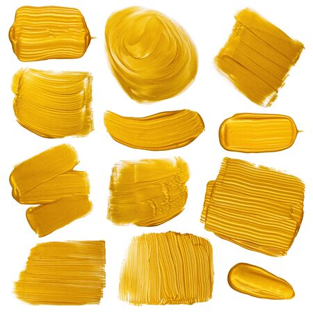 Gold paint brush strokes smugdes set. Golden metallic foil color painted design elements collection isolated on white background.