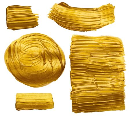 Gold paint hand brush stroke stain design elements set isolated on white background.