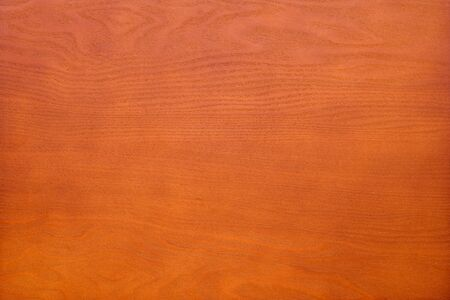 Veener wood texture background surface bright cherry colored
