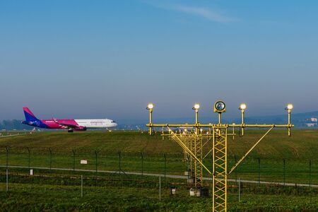 Krakow, Poland - October 24, 2019: Wizz Air passenger airplane leaves for the airport runway.