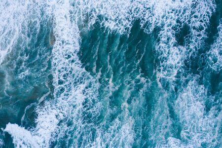 Blue ocean waves aerial drone top view