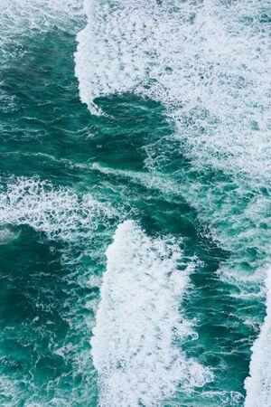 Emerald green ocean waves aerial drone top view