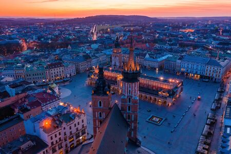 Krakow main square and st Mary basilica at dusk aerial drone view