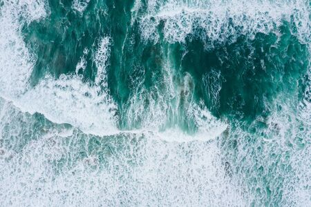 Emerald ocean waves aerial drone top view