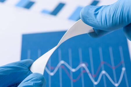 Novel flexible plastic material in scientist hands in laboratory concept Imagens