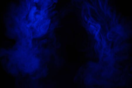 Blue smoke clouds on black, abstract background Imagens