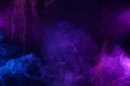 Smoke colorful clouds and shiny glitter bursts. Abstract outer space fairy tale background. Imagens