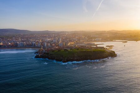 Gijon city center downtown and harbor aerial drone view. Gijón or Xixón is the biggest city in Asturias, Spain.