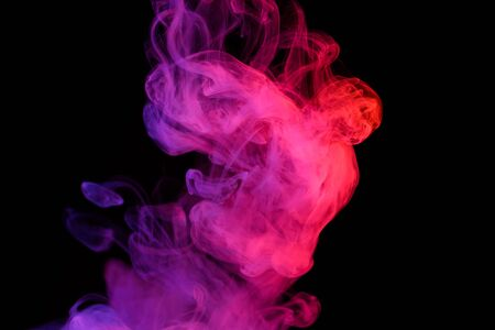 Smoke vapor puff colorful abstract shape isolated on black background