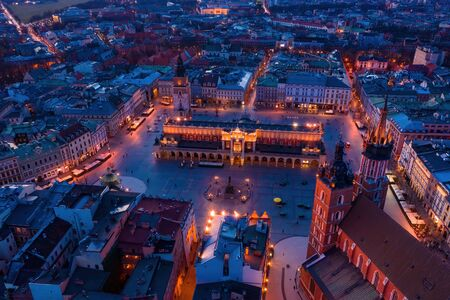 Basilica at Krakow old town city square at twilight drone aerial view