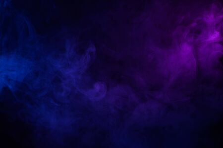 Soft clouds of colorful smoke dark abstract backgound Imagens