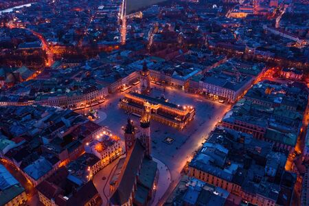 Krakow downtown aerial drone view main square at dusk, Poland Europe