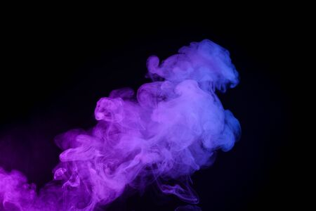 Colorufl puff of smoke isolated on black background Imagens