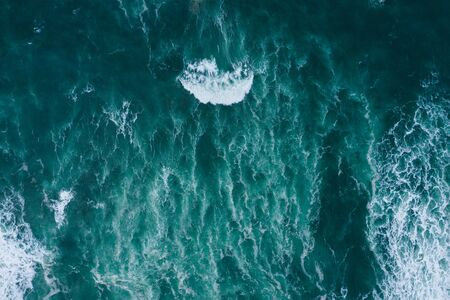 Emerald foamy ocean waves aerial drone top view Imagens