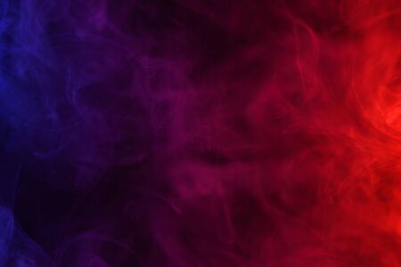 Blue pink and red smoke flowing dark abstract background