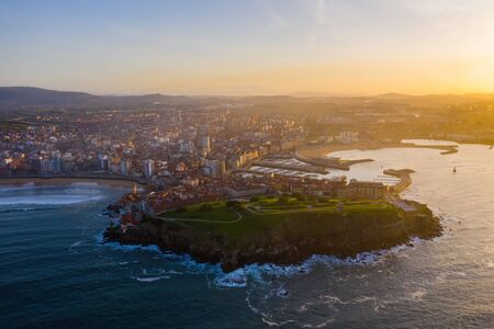 Gijon city center downtown and harbor aerial drone view in Asturias, Spain Imagens