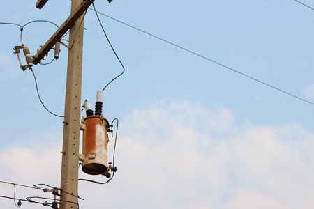 electricity transformer on the pole in thailand photo