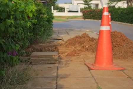 white work: zone cone red  construction roadblock danger caution Stock Photo