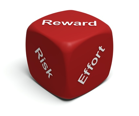 Red Dice with words Risk, Effort, Reward on faces