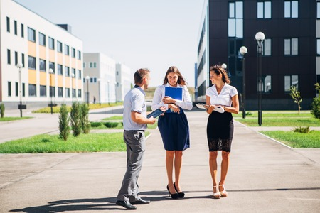northridge: three colleagues are discussing business in the modern innovation city Stock Photo