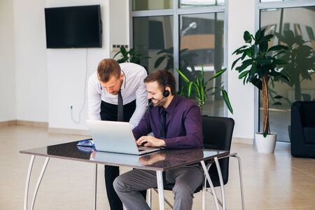 forties: two businessmen in a business meeting discussing graphics in office