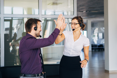 achivement: operators in the center of the number rejoice in the success Stock Photo