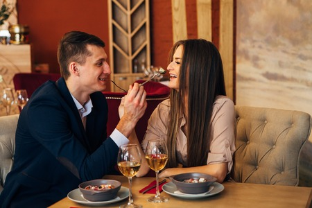Dating concept, couple drinking wine in a restaurant