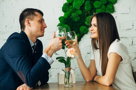 Couple celebrate Valentines day with romantic dinner in restaurant