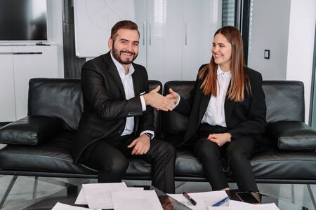 Business handshake at meeting or negotiation in the office. Partners are satisfied because signing contract or financial papers Zdjęcie Seryjne