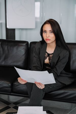 a young businesswoman poses at a corporate shoot