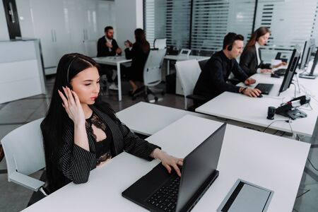A team of business people working in a call center on the line.