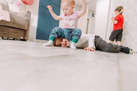 three happy children have fun at home Zdjęcie Seryjne