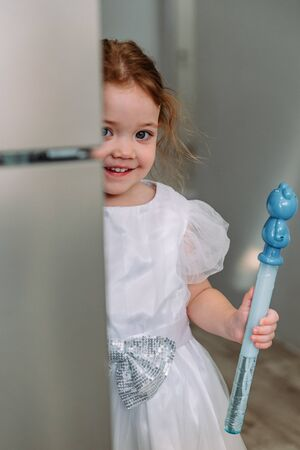 little girl with soap bubbles at home