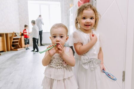 two little girls at a childrens birthday party